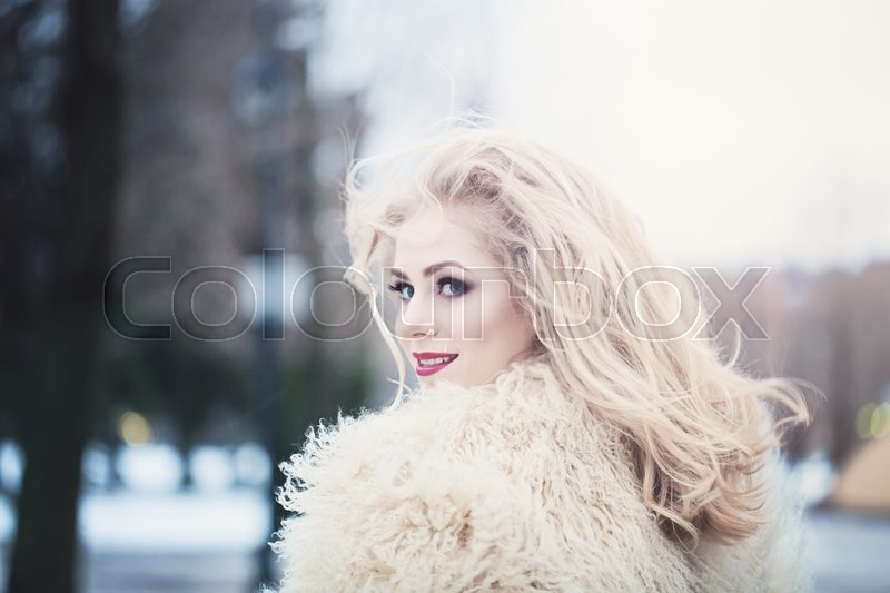 Stock image of 'Cute Happy Woman with Windy Hair'