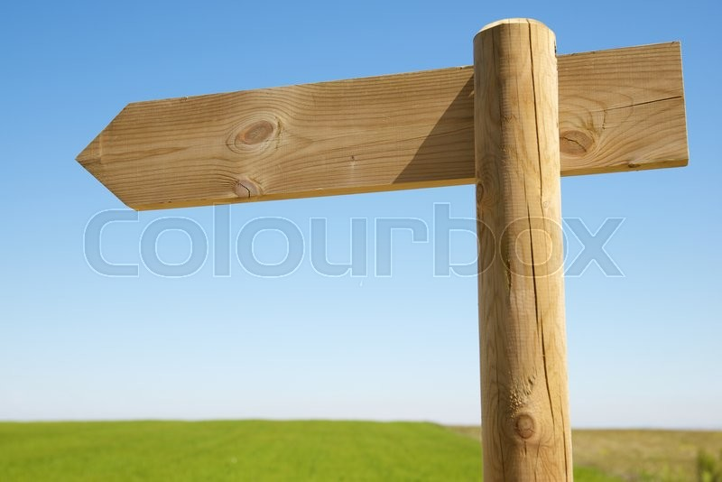 Stock image of 'View of a directional wood signal.'