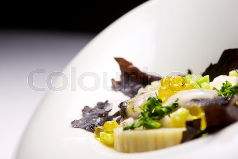 Stock image of 'Rice with oyster on a white bowl.'