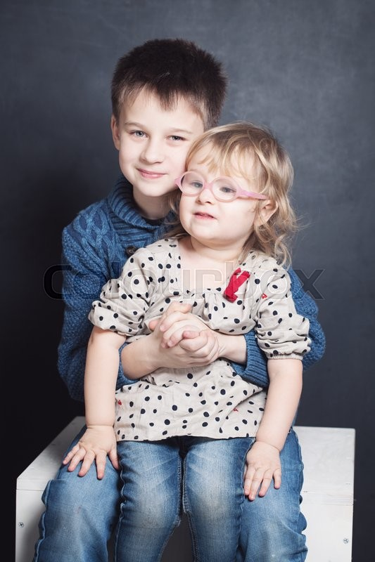 Stock image of 'Loving Sibling. Smiling Brother and Sister (2 and 10 years)'