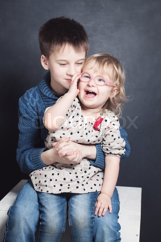 Stock image of 'Happy Brother and Sister Laugh. Sibling Boy and Girl'
