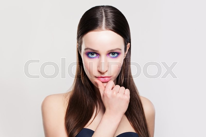 Stock image of 'Woman with Healthy Hair, Skin and Fashion Makeup'