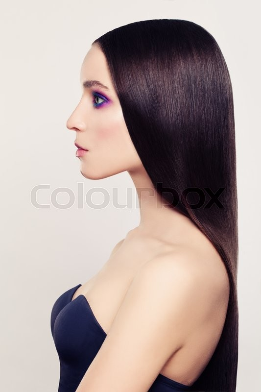 Stock image of 'Beautiful Woman with Long Coloring Hair. Profile'