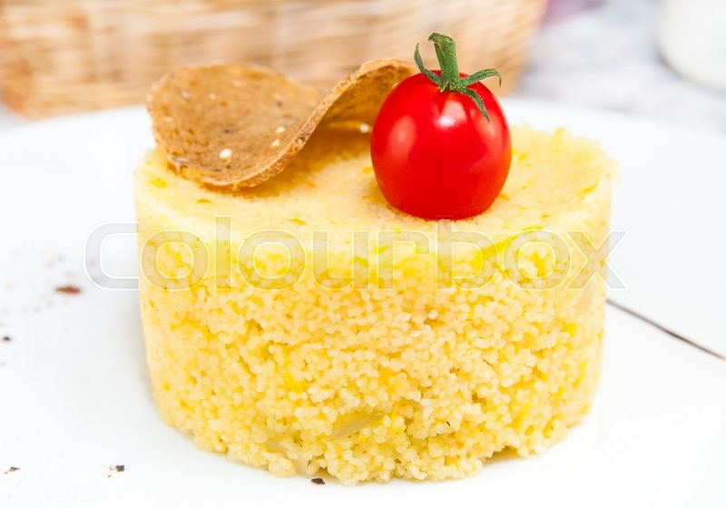 Stock image of 'Couscous embellished with eggplant and tomato'