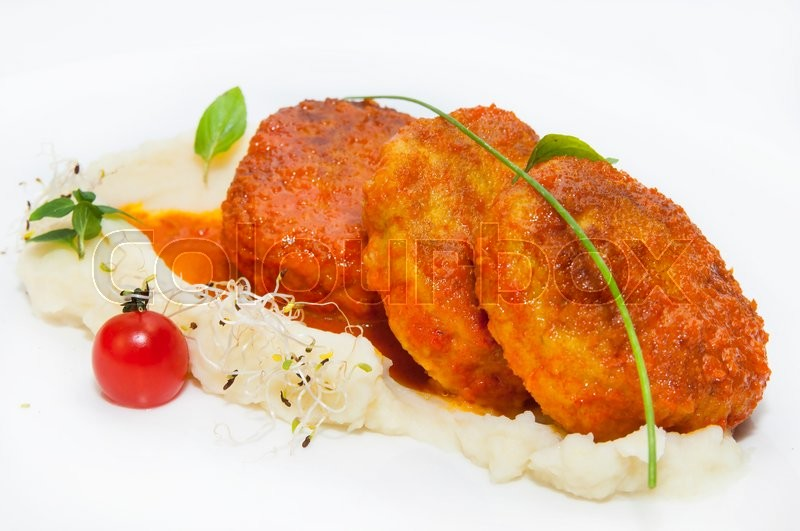 Stock image of 'Cutlets fried in carrot sauce with mashed potatoes'