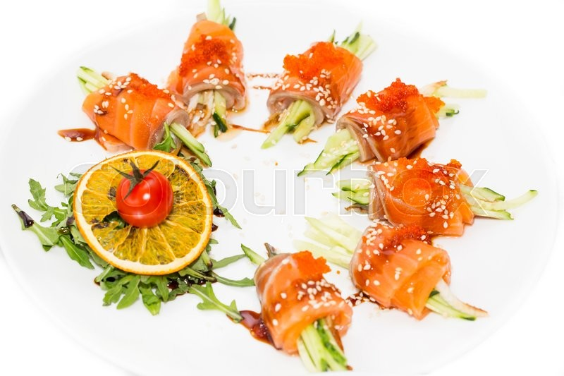Stock image of 'Fish rolls with herbs and fruit on a plate'