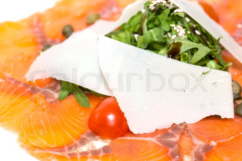 Stock image of 'Slices of salmon with herbs and cheese on a white plate'