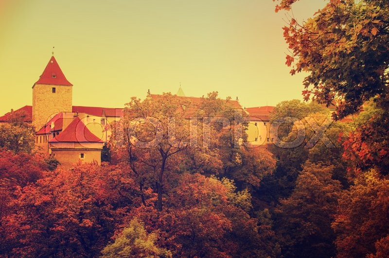 Stock image of 'Prague Castle, old city with autumn trees , european travel seasonal fall background in vintage style'