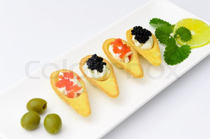 Stock image of 'Tartlets with Red and Black Caviar. Studio Photo'