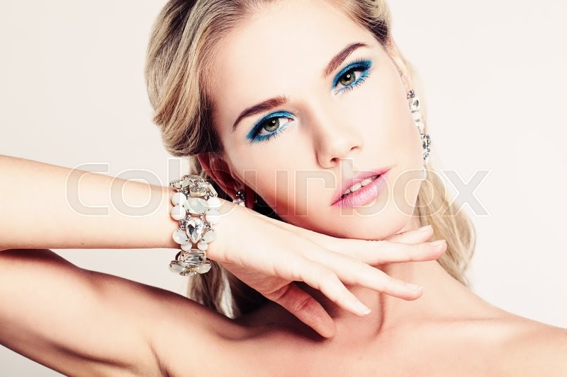 Stock image of 'Pretty Woman Fashion Model with Makeup and Bracelet'