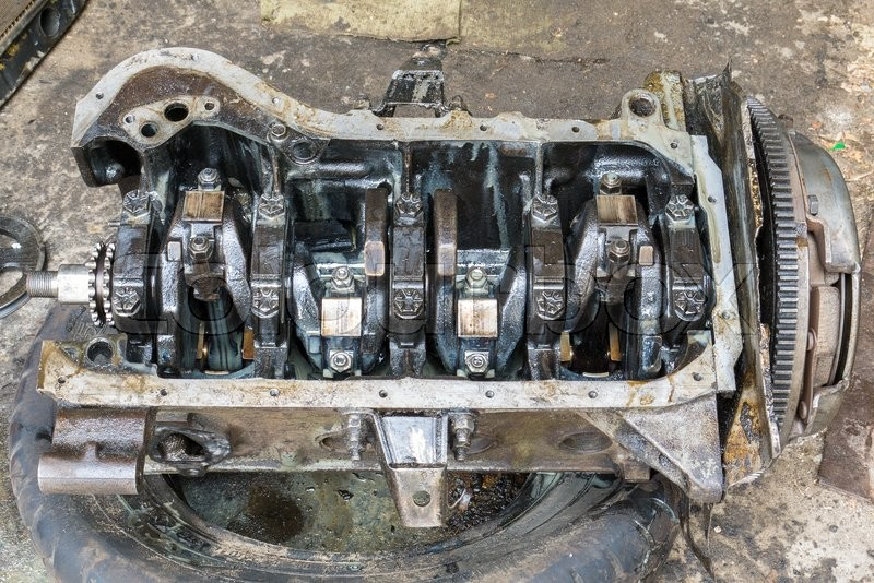 Stock image of 'old dirty disassembled car engine'
