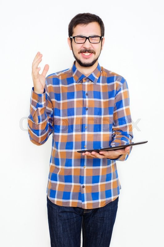 Stock image of 'smiling young man with a tablet in a studio on a white background'