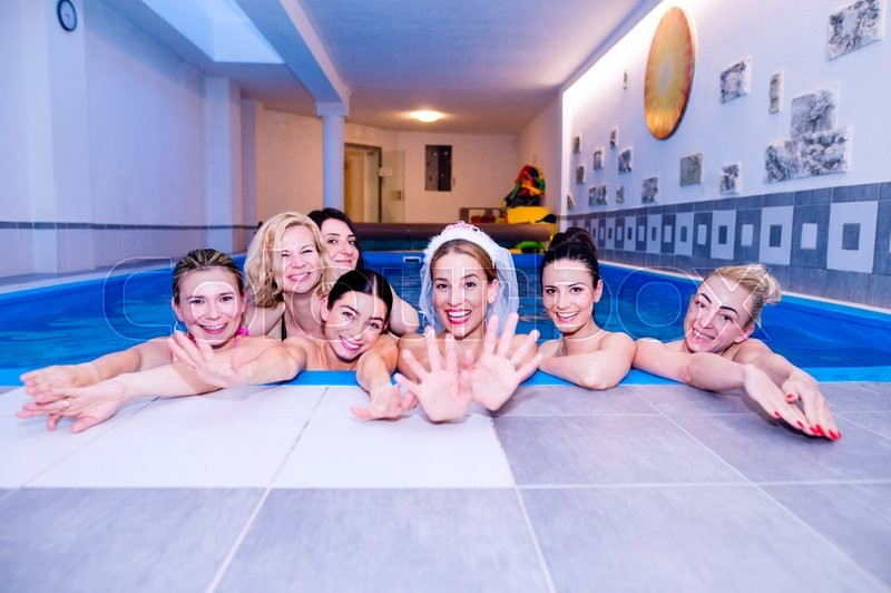 Stock image of 'Cheerful bride and happy bridesmaids in bikinis celebrating hen party in wellness center. Women enjoying a bachelorette party.'