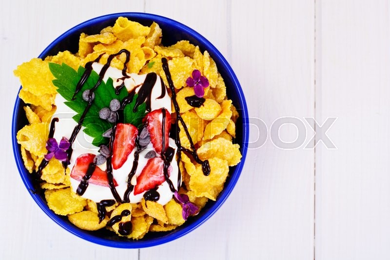 Stock image of 'Cornflakes with Strawberry and Chocolate. Healthy Breakfast Studio Photo'