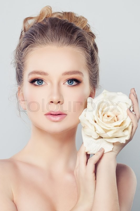 Stock image of 'Spa Woman with Blonde Hair and White Rose Flower. Skin Care Concept'