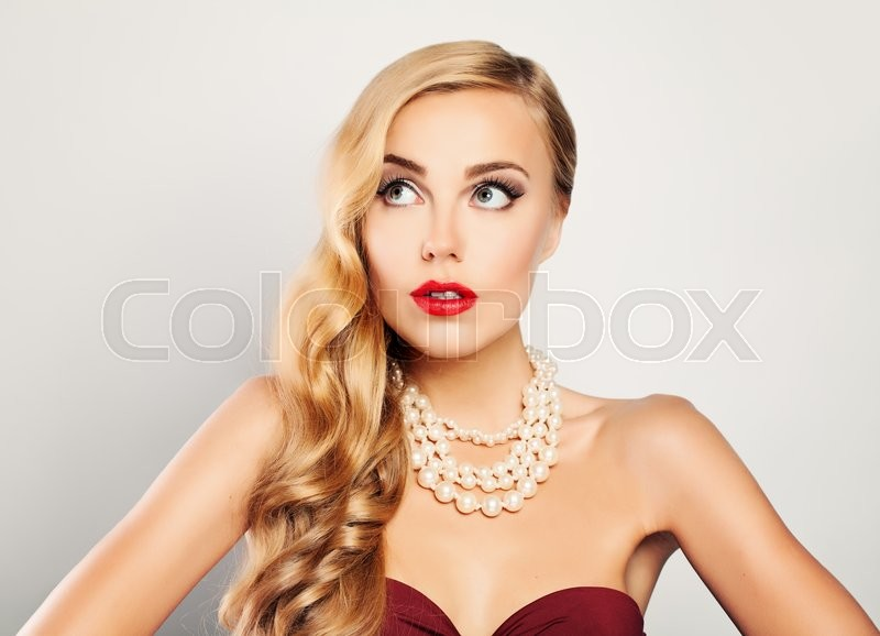 Stock image of 'Sexy Blonde Woman Looking Up'