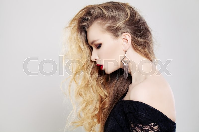 Stock image of 'Beautiful Woman with Long Wavy Blonde Hair. Female Profile'