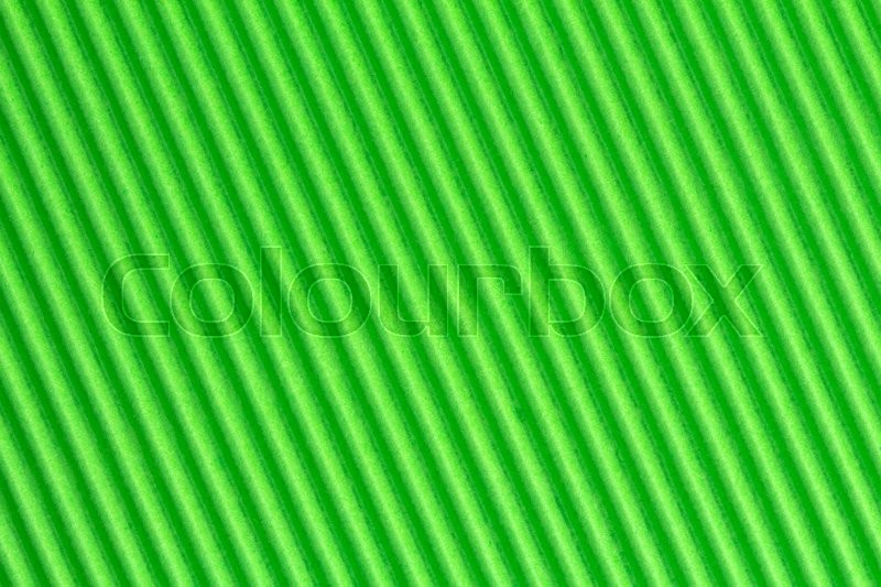 Stock image of 'Green textured corrugate cardboard, can be used as background'