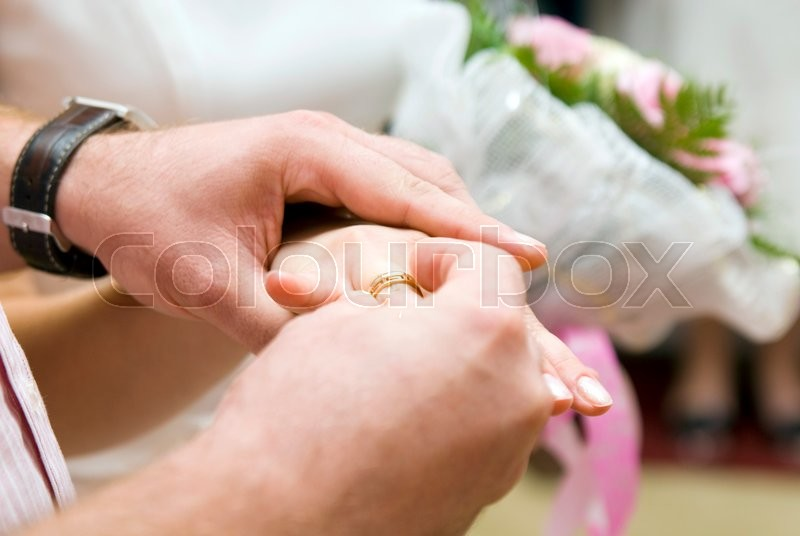 Stock image of 'The couple exchanged wedding rings during the celebration'