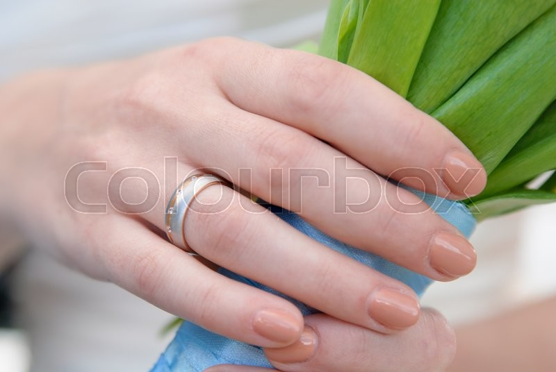 Stock image of 'wedding ring on a female hand'