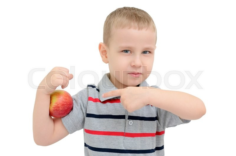 Stock image of 'Strong boy with apple isolated on white background'