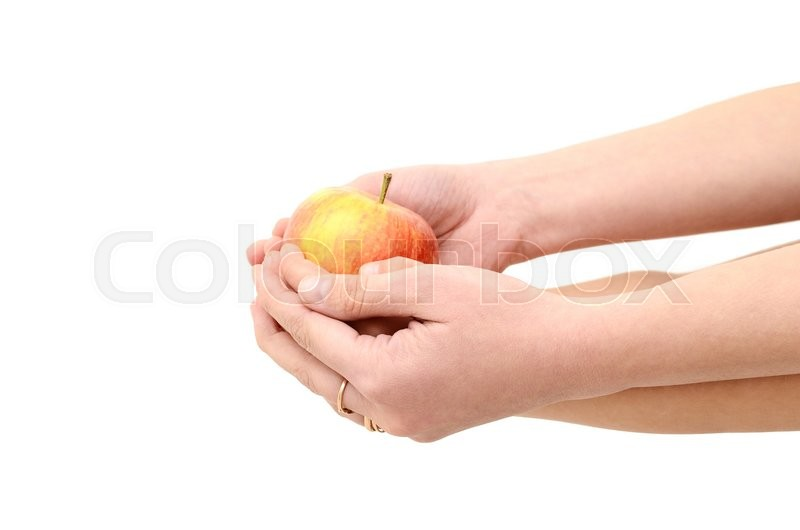 Stock image of 'Children's hands give an apple isolated on white background'
