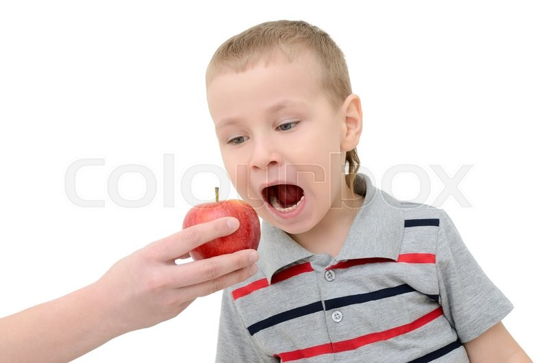 Stock image of 'Boy eats an apple on a white background'