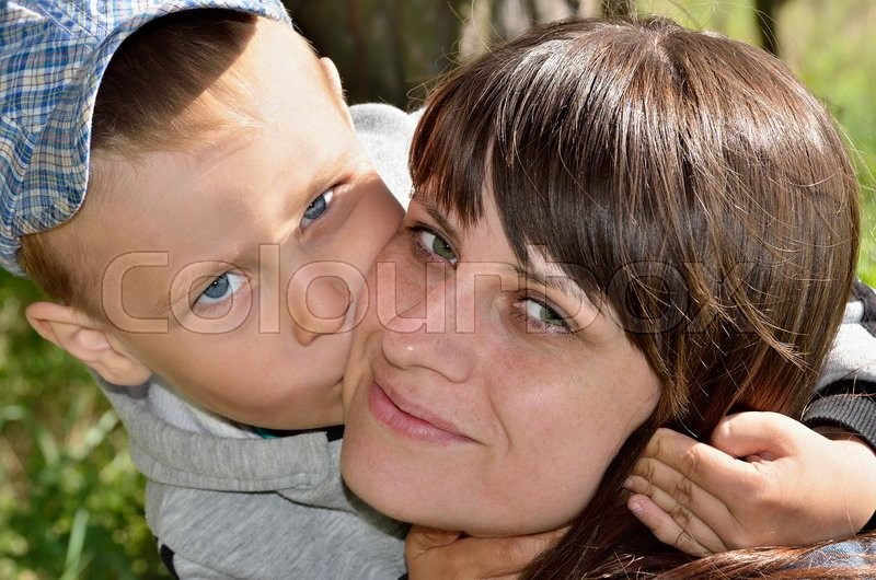 Stock image of 'Little boy hugging and kissing his mother, close-up'
