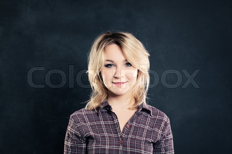 Stock image of 'Cute Woman on Dark Background. Portrait'
