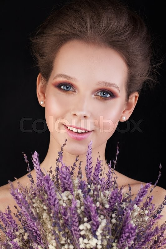 Stock image of 'Pretty Woman with Flowers on Black Background. Beauty Portrait'