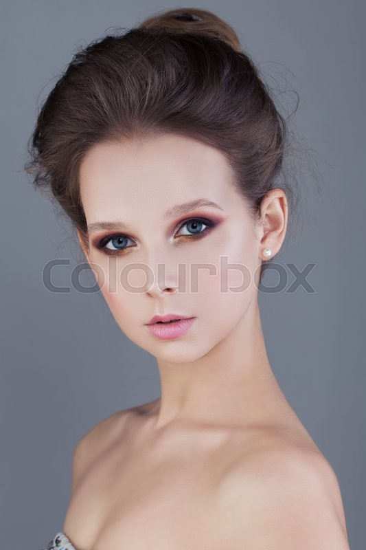 Stock image of 'Young Woman on Blue Background'