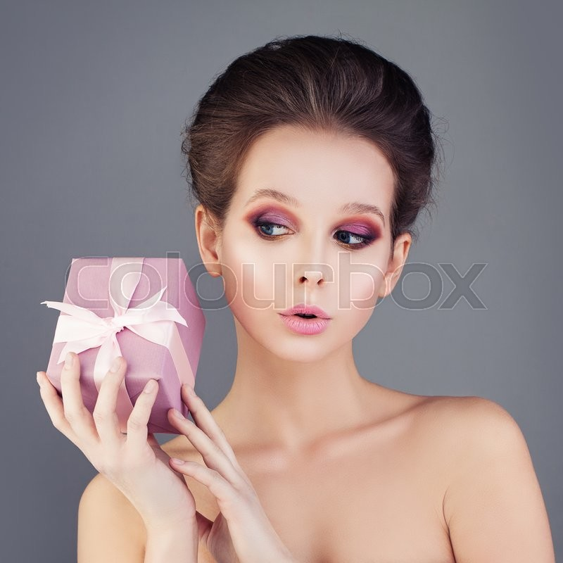 Stock image of 'Cute Girl Holding Gift Box'