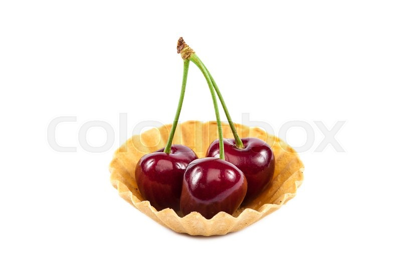 Stock image of 'Fresh a sweet cherry fruits in baskets of sand isolated on a white background.'