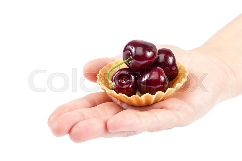 Stock image of 'Fresh a sweet cherry fruits in baskets of sand in female hand isolated on white background.'