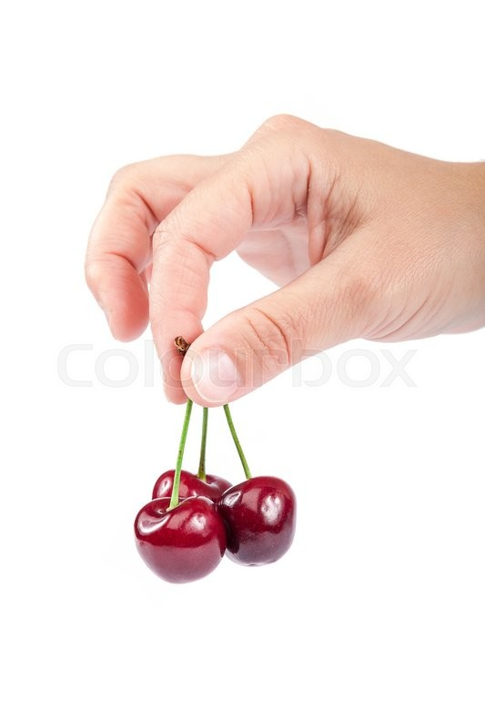 Stock image of 'Fresh a sweet cherry fruits in female hand isolated on white background.'