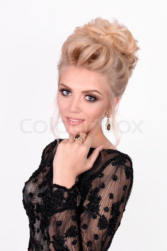 Stock image of 'Beautiful lady in elegant black evening dress with updo hairstyle. Fashion photo.'