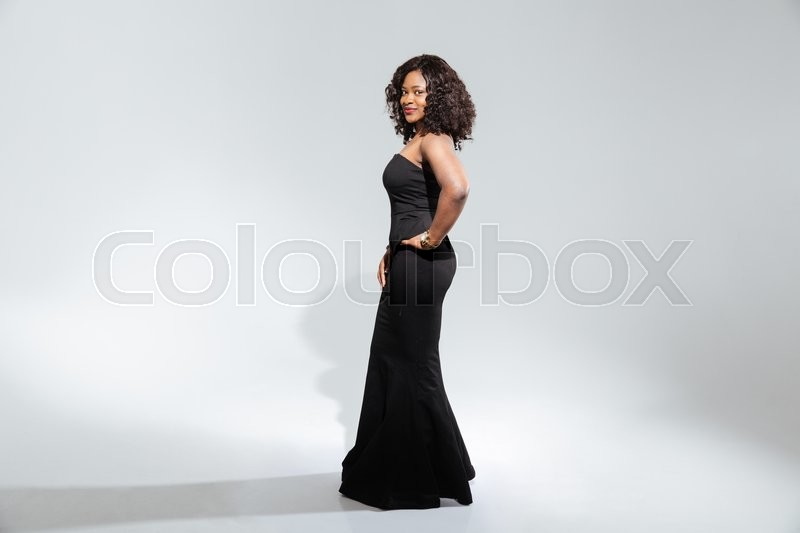 Stock image of 'Afro american woman in fashion dress posing isolated on a white background'