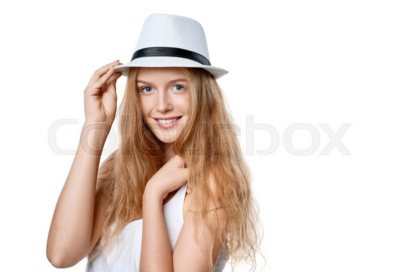 Stock image of 'Closeup of smiling woman wearing white fedora straw hat over white background'