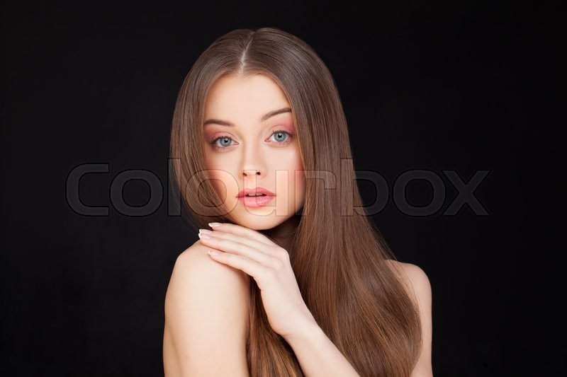 Stock image of 'Portrait of Beautiful Model on Black Background. Makeup and Healthy Hairstyle'