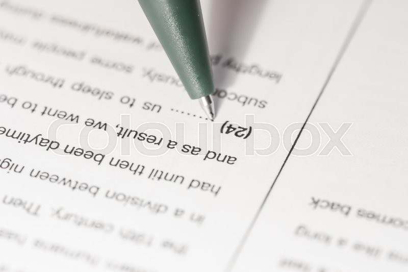 Stock image of 'language test paper with word filling gaps'