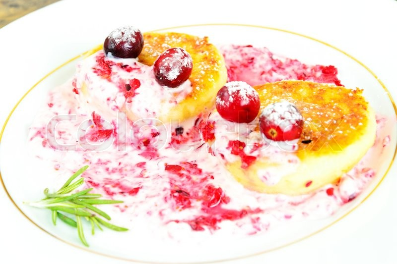 Stock image of 'Tasty and Healthy Food: Delicious Cheesecake with Cranberries. Studio Photo'