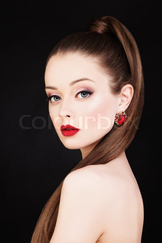 Stock image of 'Beautiful Woman. Makeup and Long Healthy Hairstyle'