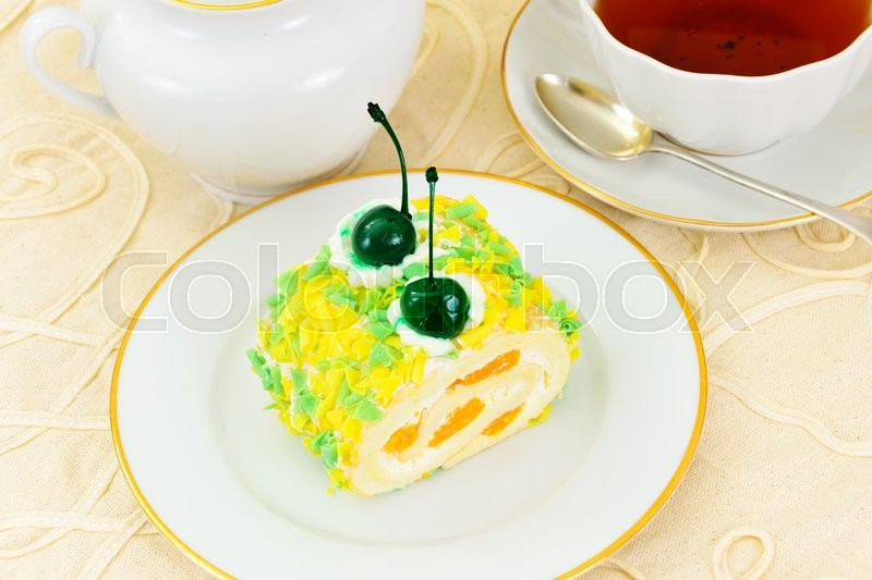 Stock image of 'Biscuit and Cake with Mandarin and Whipped Cream. Studio Photo'