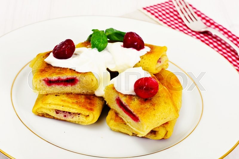 Stock image of 'Pancakes with Cherries Studio Photo'