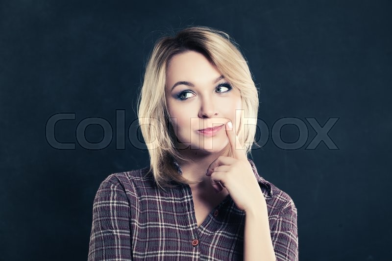 Stock image of 'Thinking Woman on Dark Background'