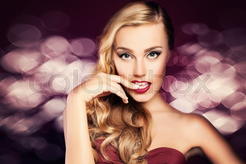 Stock image of 'Fashion Woman on Glitter Party Background'