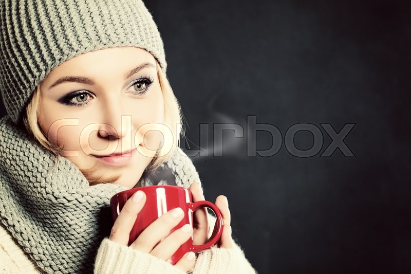 Stock image of 'Woman Drinking Coffee or Tea. Winter Drink '
