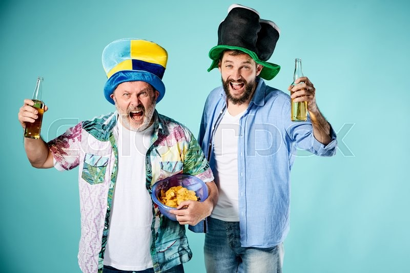 Stock image of 'The two football fans over blue background'