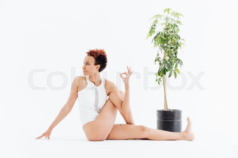 Stock image of 'Pretty african american young woman relaxing and practicing yoga'