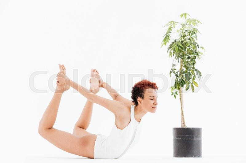Stock image of 'Pretty african american young woman exercising and practicing yoga'